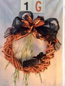 Orange grapevine Halloween wreath with black and orange ribbon