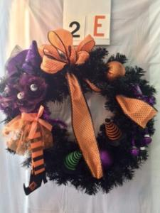 Halloween wreath with witches sock and hat