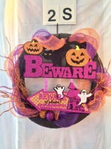 "Halloween wreath with ""Beware"" and arrow"