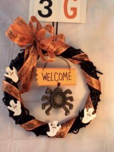 """Halloween wreath with """"Welcome"""" and spider"""