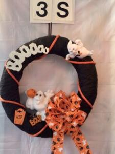 Halloween wreath with ghosts and Boooo
